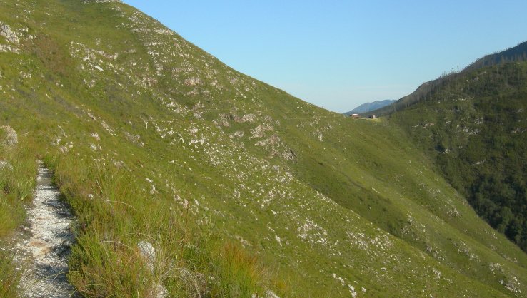 View of Windmeulnek Hut nestled between the two butresses taken whilst walking towards Platbos Hut