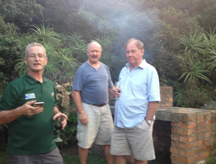 The guys assist the potjie by downing some of the copius supply of wine magnums that Malcolm had generously provided