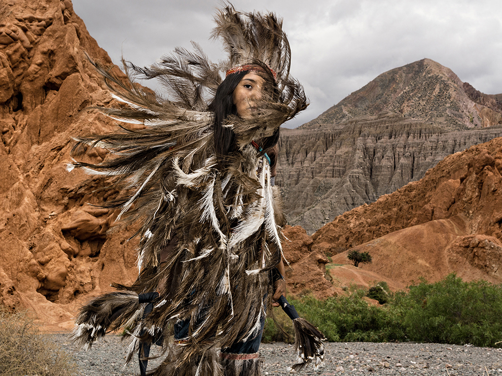 Belén Cruz's feathered costume represents the nandu, or rhea, sacred bird of the Suris in Argentina