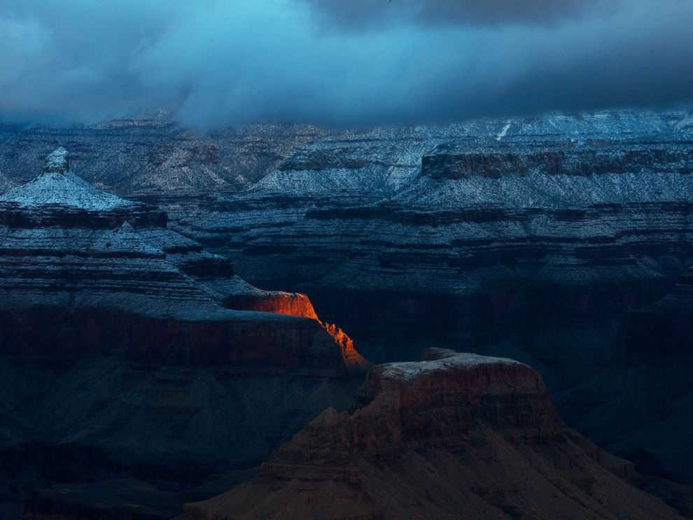 Predawn sunlight strikes the South Rim of Arizona's Grand Canyon