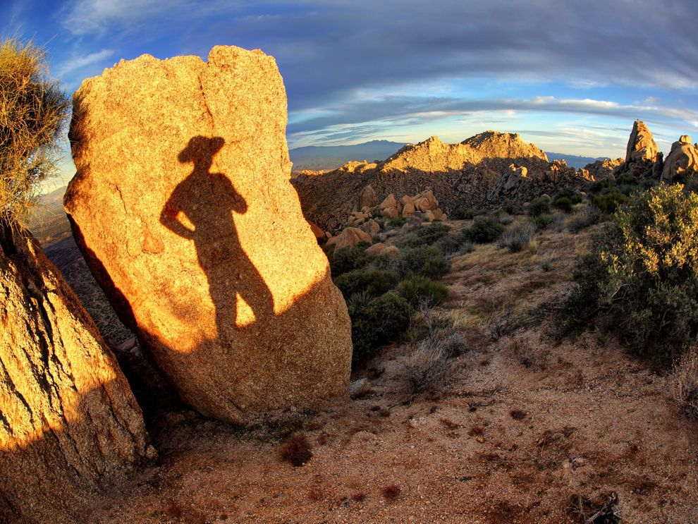Using the sun and an Arizona landscape a photographer creates this self-portrait
