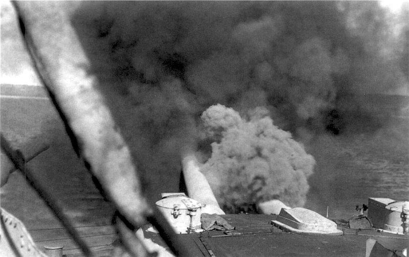 HMS Canopus fires a salvo from her 12 in (300 mm) guns against Ottoman forts in the Dardanelles