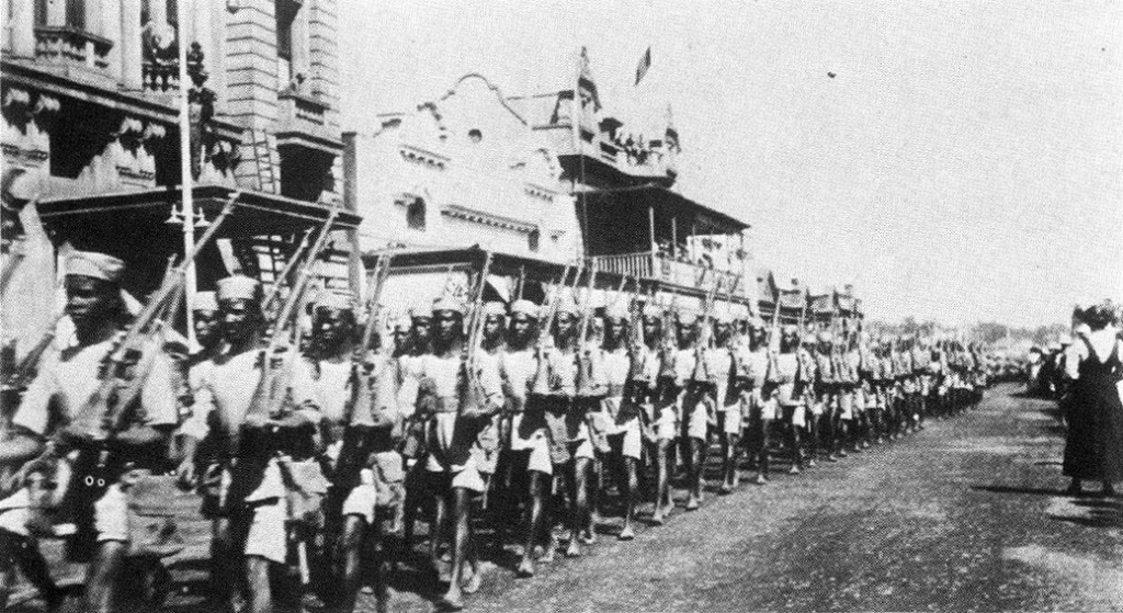 Men of the 1st Rhodesia Native Regiment marching through Salisbury before going to East Africa, 1916