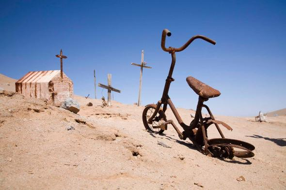 A rusted bicycle in a cemetery creates a bleak scenario in the Atacama Desert in Chile.