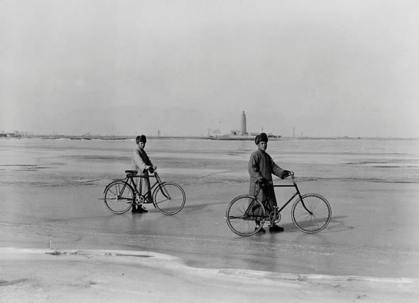 Two men proudly pose with their bicycles—zi xing che in Mandarin—during the 1930s in China. Inexpensive and convenient, bikes are an important form of Chinese transportation.