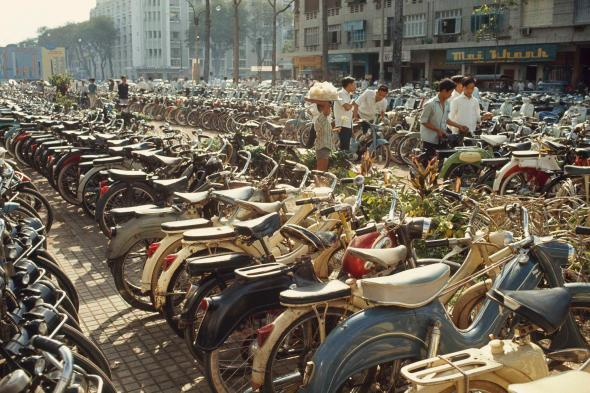 Parked bicycles crowd a downtown boulevard in Saigon, South Vietnam, in a photo from a 1965 issue of National Geographic. In the mid-1900s, the city's bicycle population was estimated at 1,500,000.