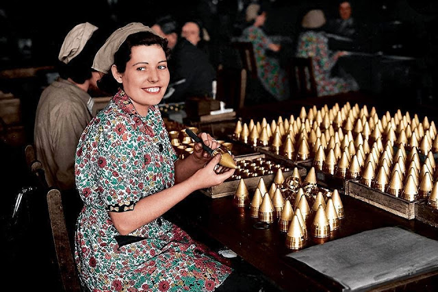 Girls working on shell caps in a munitions factory, somewhere in England. 25th of May 1940. (Source - Gettys Images - Photographer, Paul Popper. Colorized by John Gulizia from America)