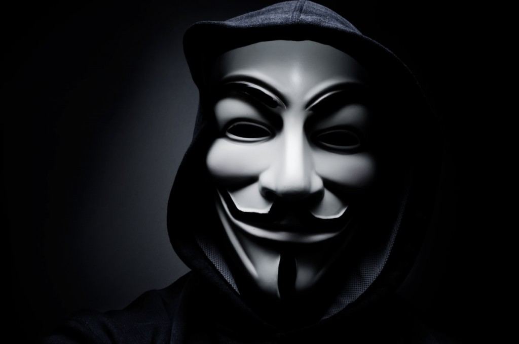 stock-photo-paris-france-january-man-wearing-vendetta-mask-this-mask-is-a-well-known-symbol-for-244924321