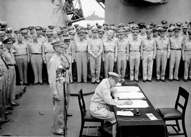 1945. Douglas MacArthur signing the official acceptance of Japanese surrender