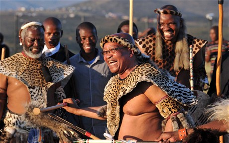 South African President Jacob Zuma (C) dancing in traditional Zulu dress during a traditional wedding