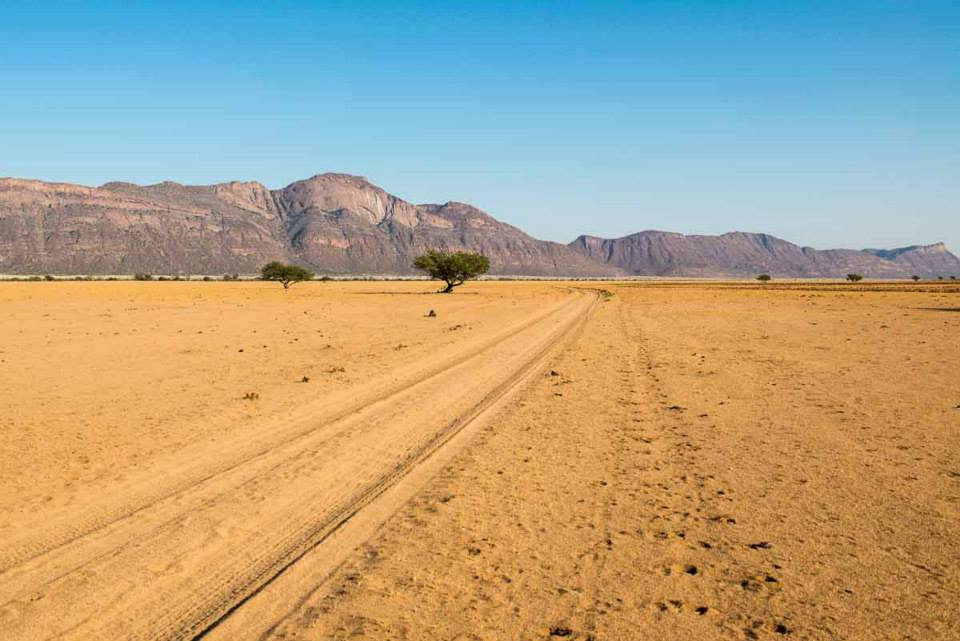 The road north up the Marienfluss, Kaokoland, with Mt. Ondau on the left. An area of great spiritual significance to the Himba people