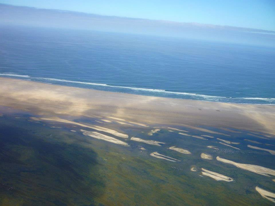 The sand peninsula that forms the Bay of Walvis Bay. The tip is called Pelican Point.