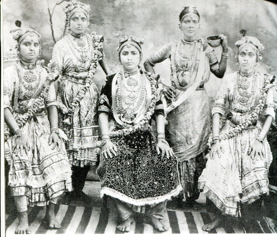 Pre-colonial Indian prostitues. It featured around nine different tiers of sex workers. At the bottom, you'd find devadasis, originating from the untouchable caste. Unwillingly sold by their parents at ages as low as four, these women are forever pledged to the goddess of fertility, Yellamma. As they're unable to marry mortal men, they work until they're no longer considered young and attractive, and are cast out to live the remainder of their lives as beggars.