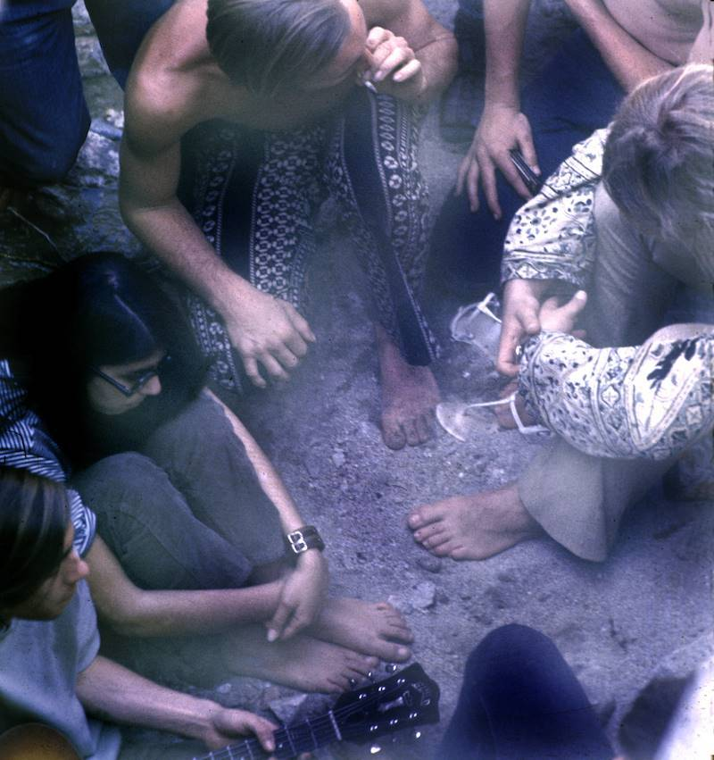 A hippie commune sharing a joint