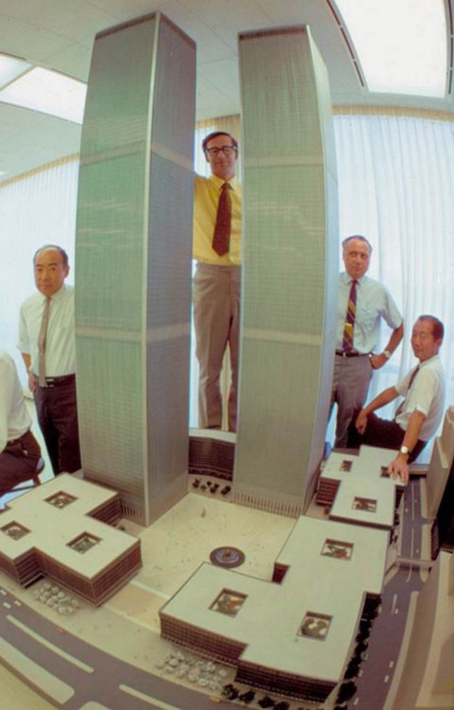 Minoru Yamasaki (right) posing with a model of the World Trade Center he designed, 1964