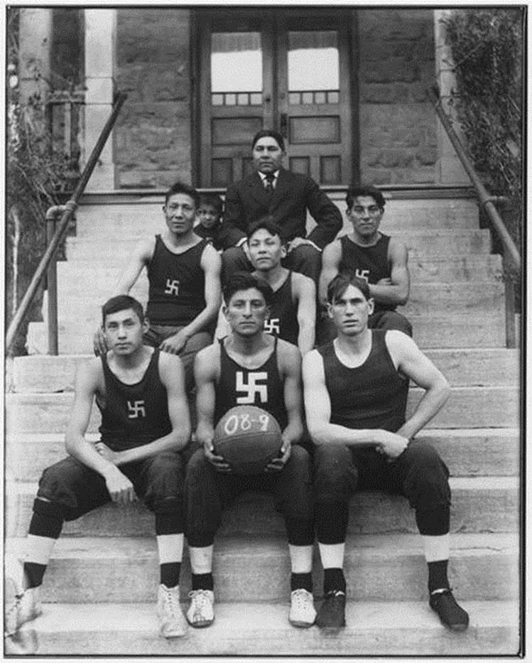 North American native Chilocco Indian Agricultural School basketball team in 1909. Originally, the swastika is a sign of good fortune