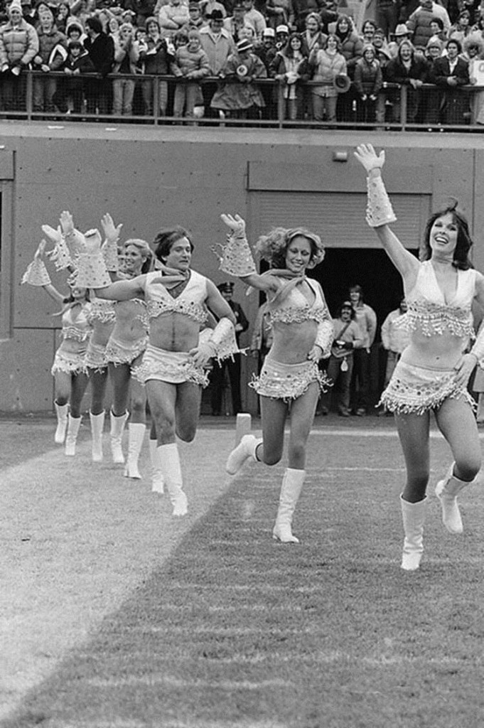 Robin Williams joins the stunning women of the Denver Broncos' Pony Express as pro football's first male cheerleader and prances before 70,000 cheering fans in Denver's Mile High Stadium