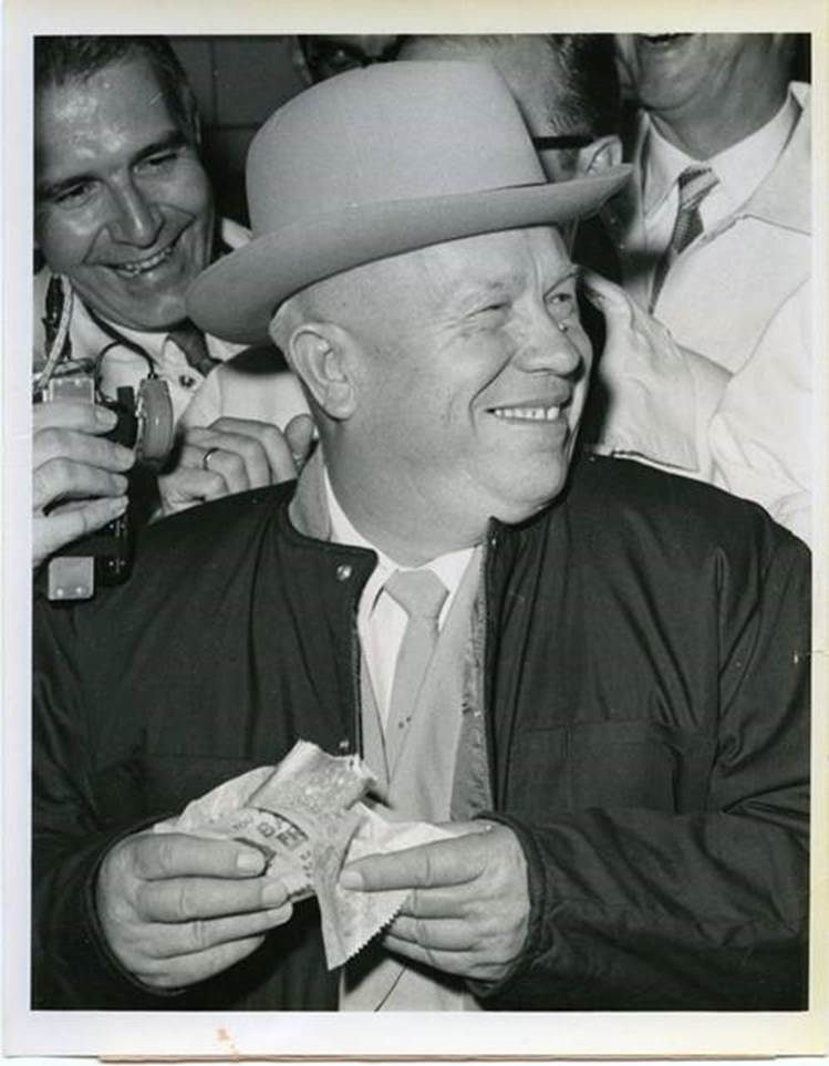 "Soviet Premier Nikita Khrushchev eating a hot dog in Des Moines, Iowa, on which he commented ""It's excellent… we make good sausages but yours are better"", 1959"