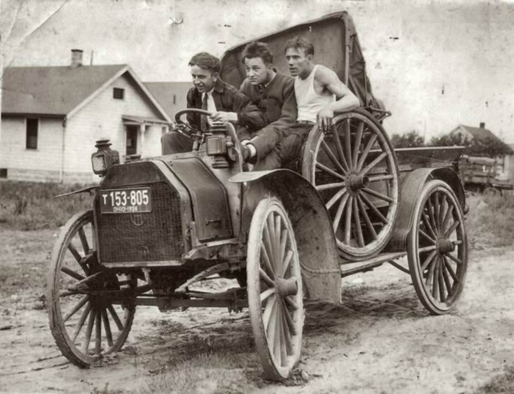 Three friends take a joyride on their 'new' vehicle, Ohio, c. 1924