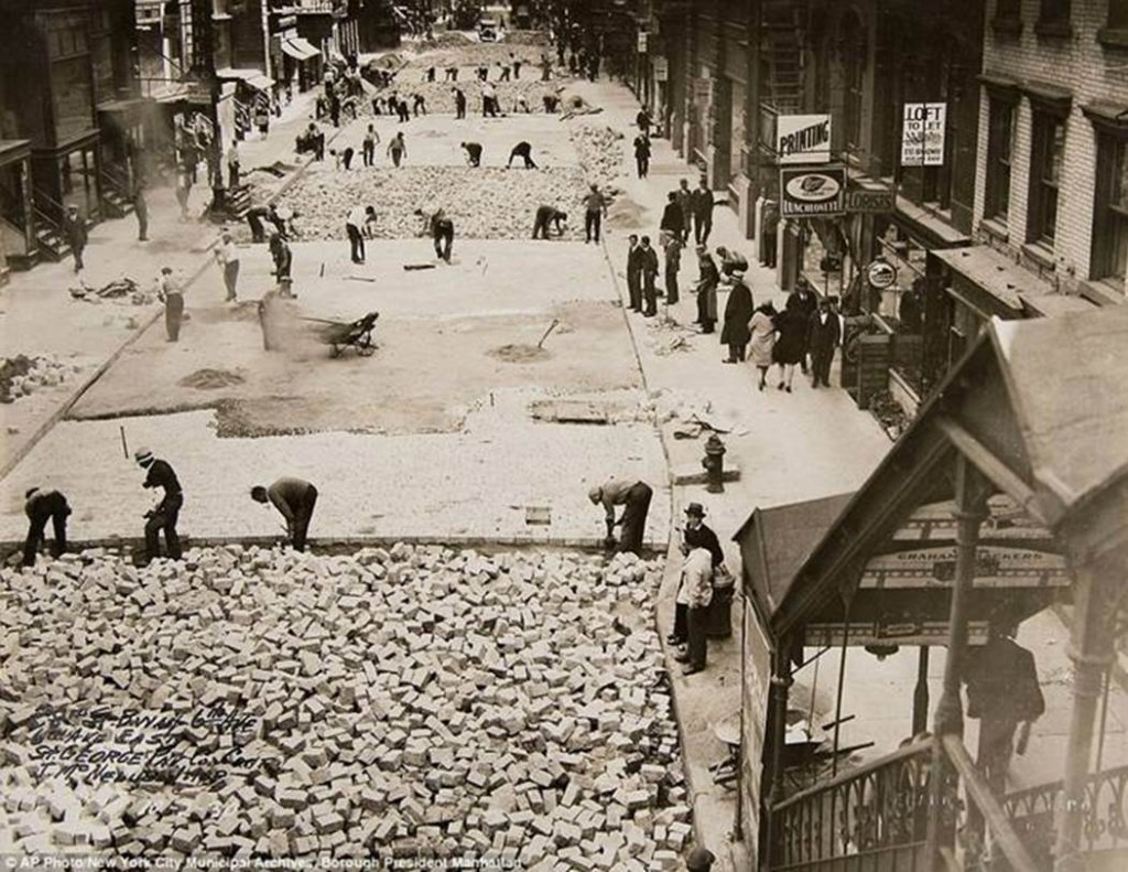 Workers lay bricks to pave 28th Street in Manhattan, 1930