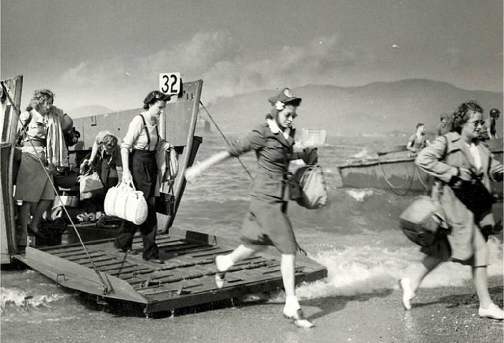 A Normandy Beach landing photo they don't show in textbooks - Brave women of the Red Cross arriving in 1944 to help the injured troops, WWII.