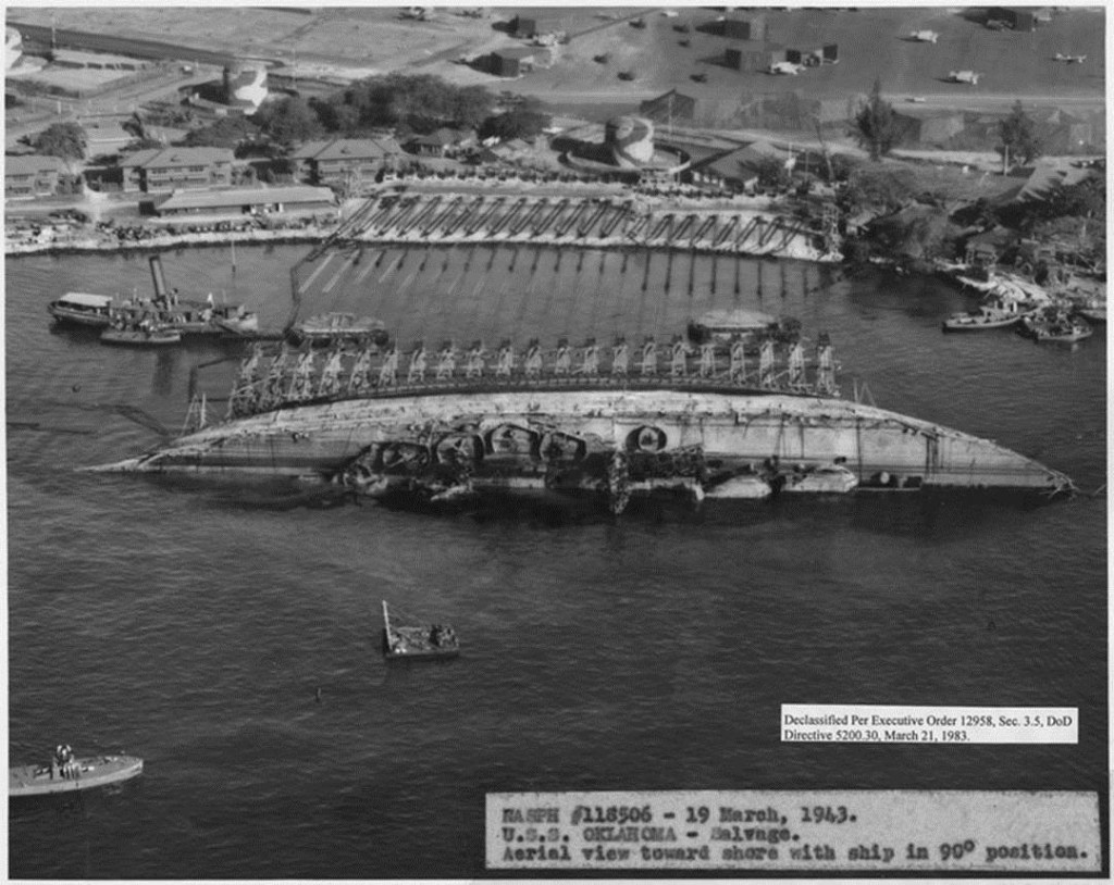 Righting the overturned hull of USS Oklahoma at Pearl Harbour, 19 March 1943