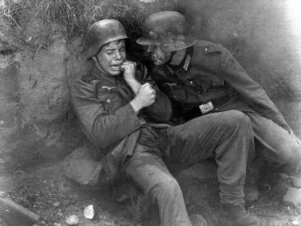 This photo, taken at the end of the war shows a young boy terrified by the sounds of battle. He even wet his pants