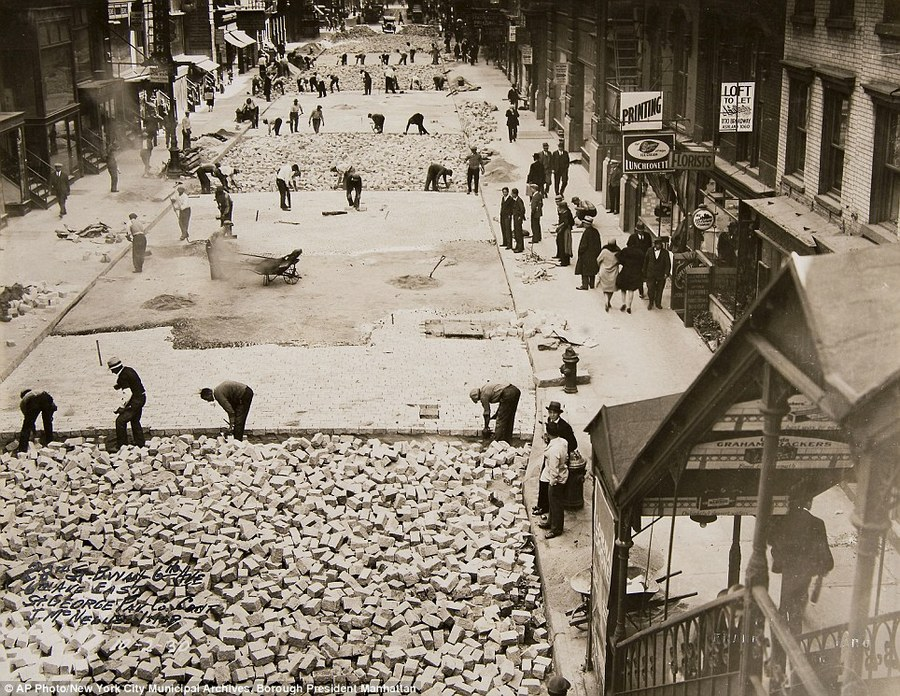 20 Workers lay bricks to pave 28th Street in Manhattan, 1930