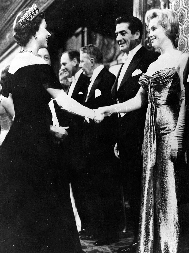 24 Victor Mature, Marilyn Monroe and Queen Elizabeth (both 30 at the time) meet at a movie premier in London. October 1956