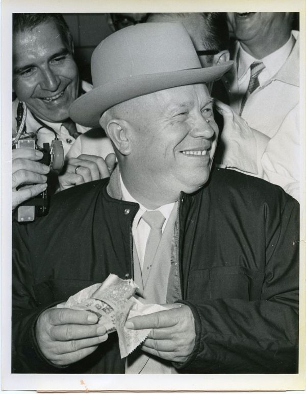 "26 Soviet Premier Nikita Khrushchev eating a hot dog in Des Moines, Iowa, on which he commented ""It's excellent… we make good sausages but yours are better"", 1959"