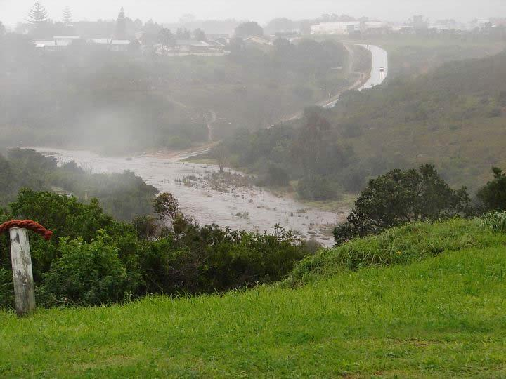 An overflowing Baakens river at Third Avenue, Newton Park, normally a trickle has swollen into a raging torrent.
