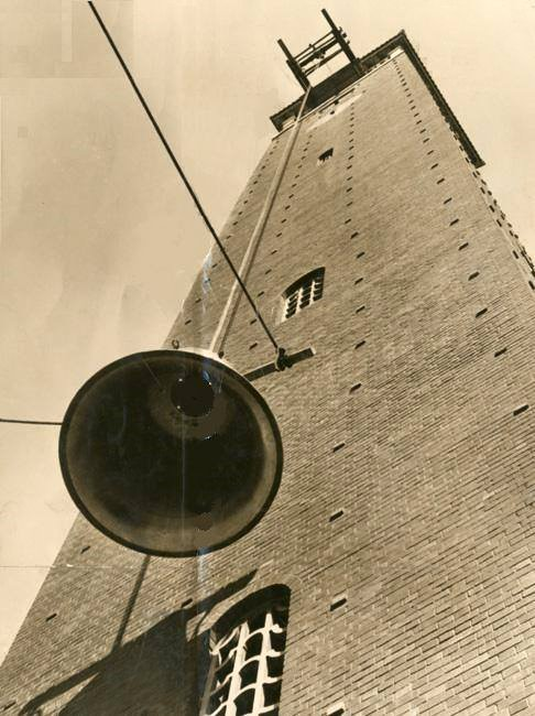 Bell being hoisted up the Campanile