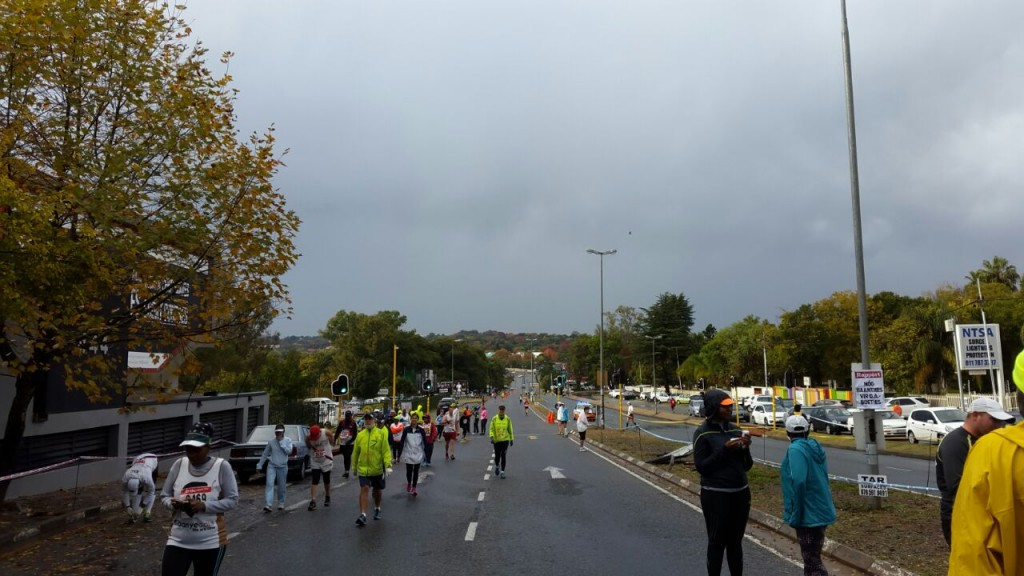 The slow but steady trick of dedicated runners makes its way to the start in Jan Smuts Avenue
