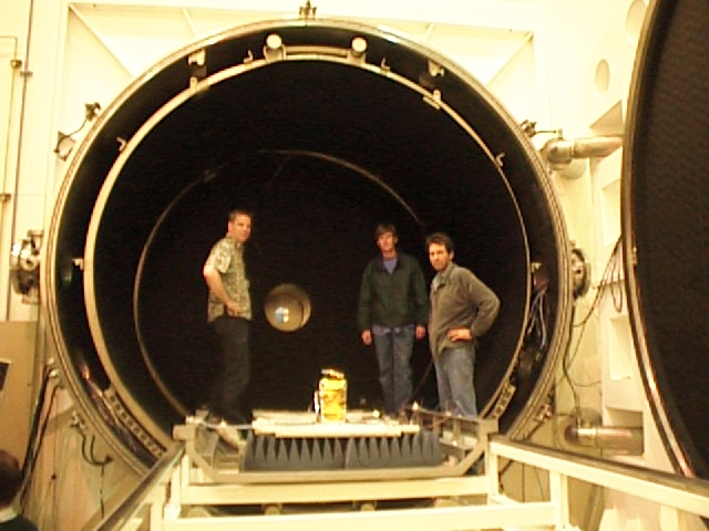 Overkill - 3 small antennas (face down on the anechoic foam) being loaded into the ridiculously large thermal vacuum chamber at Houwteq (L-R Clark, Ian George, me)
