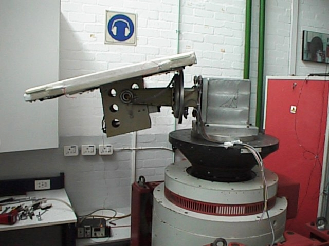 SHUCS on its positioner mounted to a vertical axis shaker at Tellumat. All other orientations of the positioner and angles of the antenna still had to be tested. A lot of work