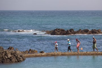 Walking across the wall of the main tidal pool