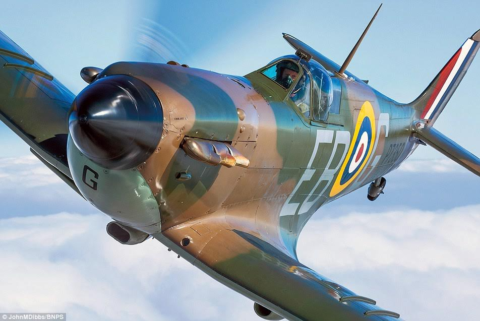 Ceremonial - The Battle of Britain memorial flight's Merlin powered Mk IIa Spitfire P7350, complete with brown and green camouflage.