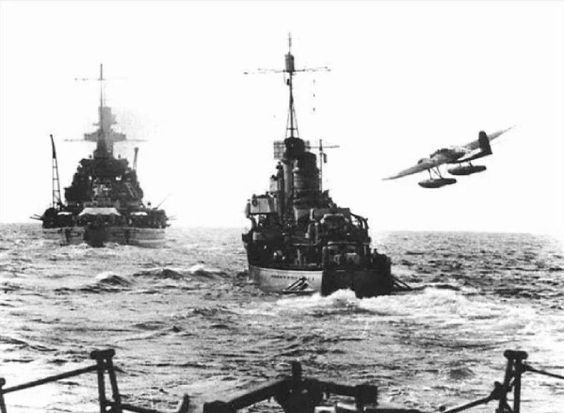KMS Scharnhorst and a destroyer escorted by an He 115 on anti-submarine patrol, most likely in the Arctic going after a convoy to Murmansk.