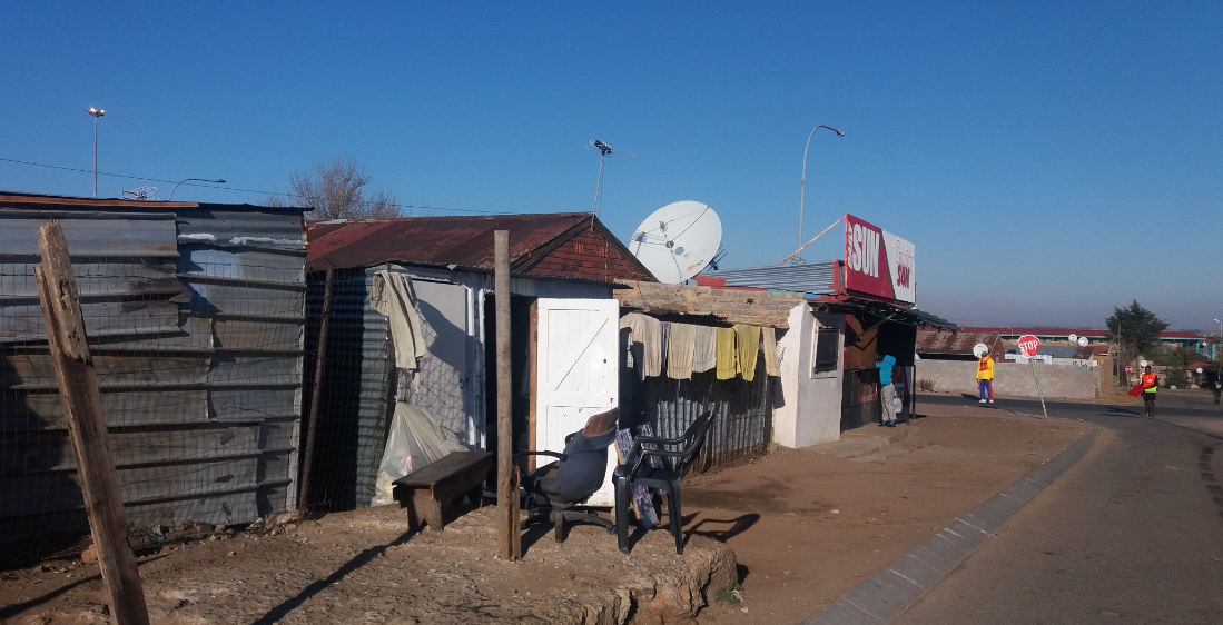 Shack with a huge satellite dish. Residents refuse to pay for electricity but 50% of houses and even shacks have satellite TV