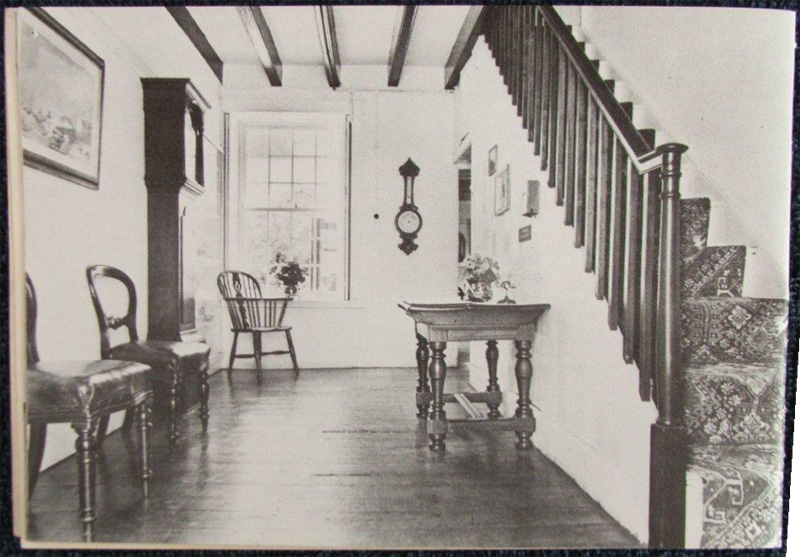 A steep stairway with a simple wooden hand-rail leads from the entrance hall to the bedrooms above.