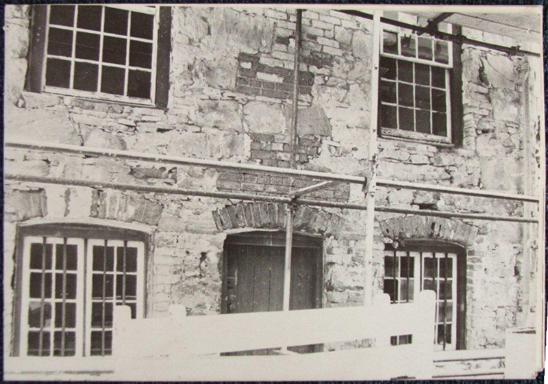 Decayed plaster was removed from the external walls during repairs in 1963, revealing the random stone coursing supplemented with brick.