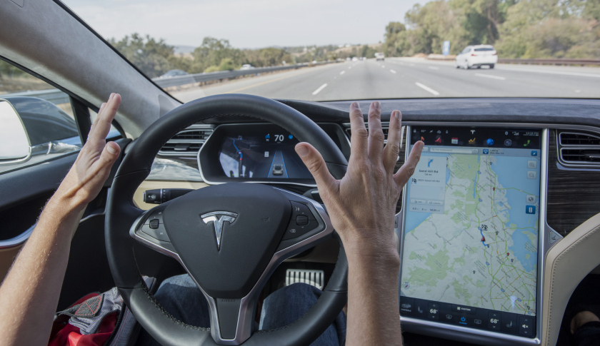 """Tesla Motors Inc. Model S car equipped with Autopilot in Palo Alto, California, U.S., on Wednesday, Oct. 14, 2015. Tesla Motors Inc. will begin rolling out the first version of its highly anticipated """"autopilot"""" features to owners of its all-electric Model S sedan Thursday. Autopilot is a step toward the vision of autonomous or self-driving cars, and includes features like automatic lane changing and the ability of the Model S to parallel park for you. Photographer: David Paul Morris/Bloomberg via Getty Images"""