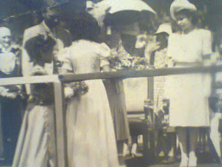 Joan Assam presenting the bouquet to Her Majesty Queen Elizabeth