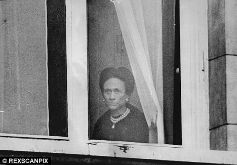 A forlorn Wallis Simpson looking out her window during Trooping The Colour in 1972