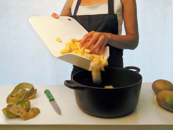"A combined cutting board with a ""spout""/canal"
