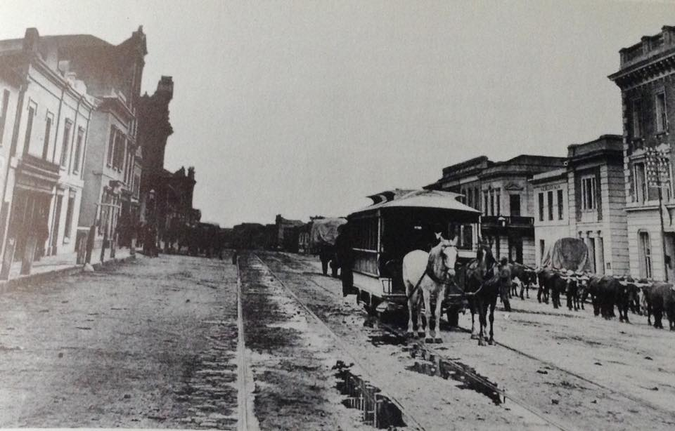 a-muddy-main-street-1885-showing-a-horse-drawn-tram