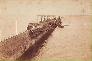 19th century photo of a steam locomotives on the jetty
