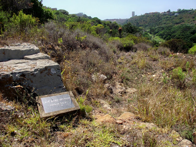 A plaque identifying that these are Boer War trenches