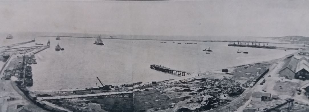 Port Elizabeth harbour under construction with the Titan crane on the breakwater