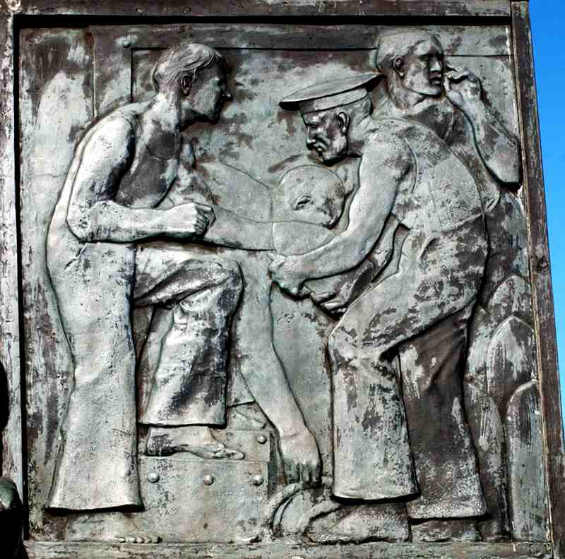 The relief panel on the side of the sarcophagus